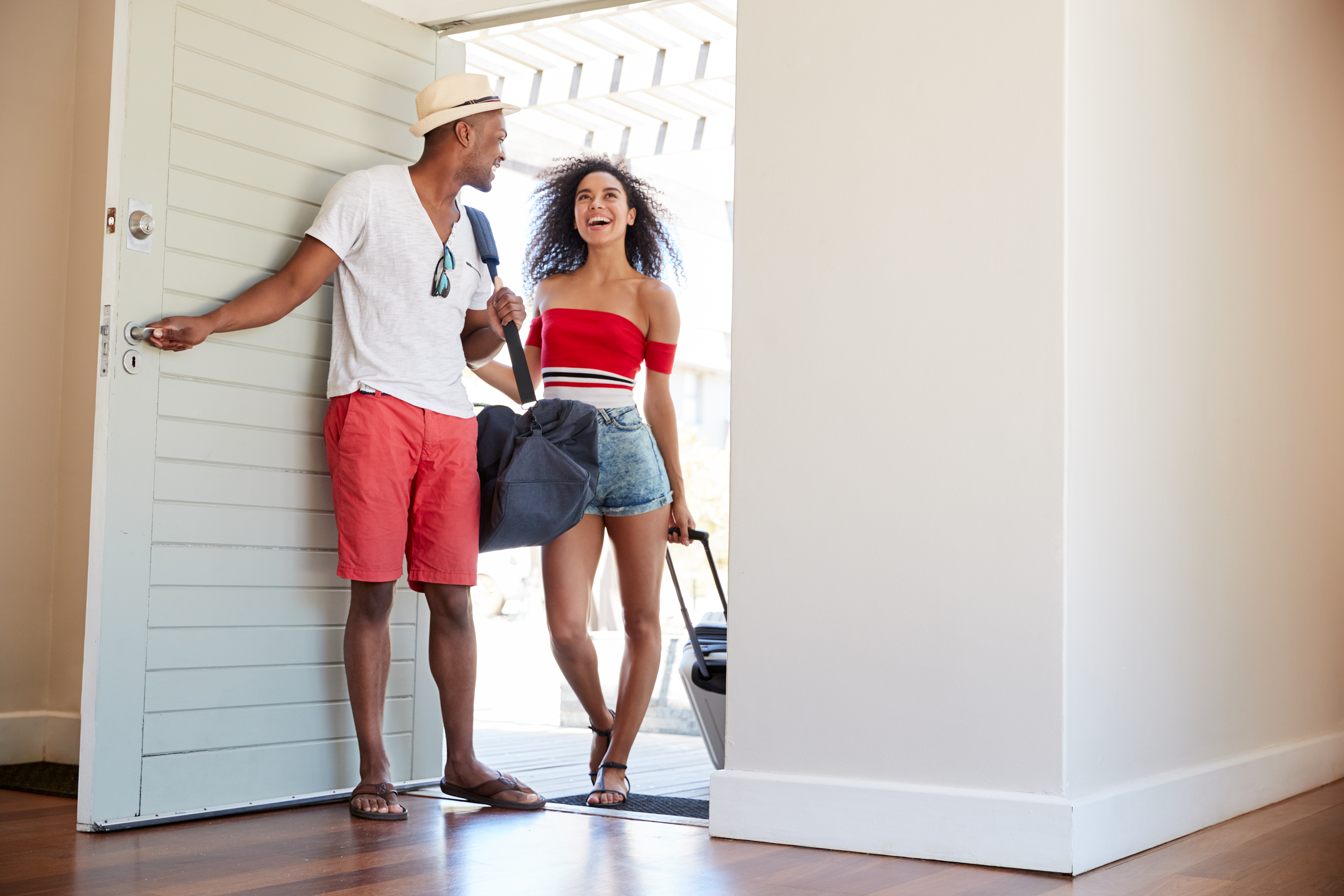 Couple walking into vacation rental